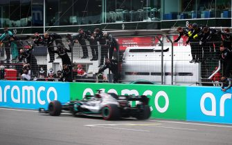 NUERBURG, GERMANY - OCTOBER 11: Mercedes GP team members celebrate on the pitwall as Lewis Hamilton of Great Britain driving the (44) Mercedes AMG Petronas F1 Team Mercedes W11 crosses the line to win during the F1 Eifel Grand Prix at Nuerburgring on October 11, 2020 in Nuerburg, Germany. (Photo by Joe Portlock/Getty Images)