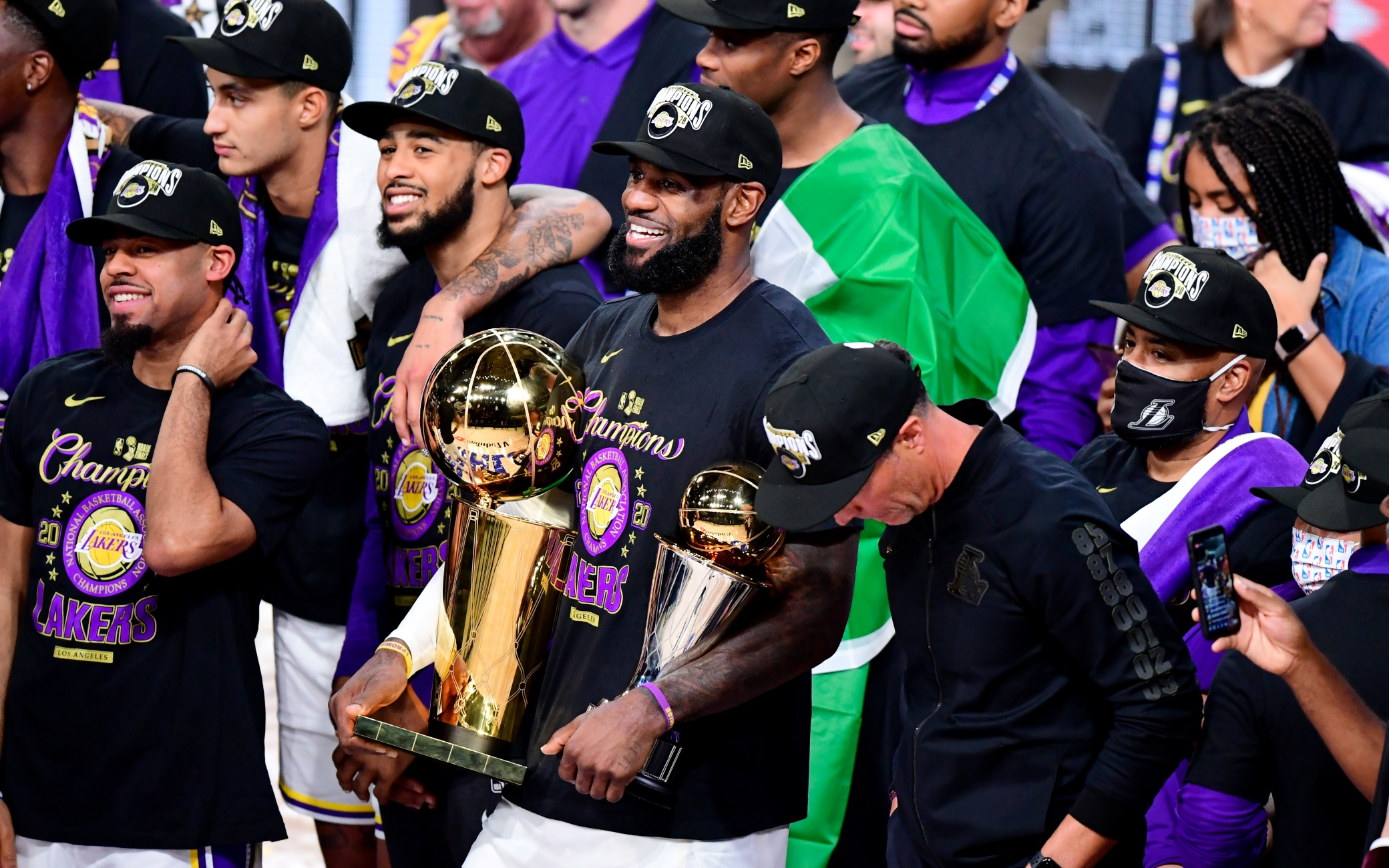 LAKE BUENA VISTA, FLORIDA - OCTOBER 11: LeBron James #23 of the Los Angeles Lakers reacts with his MVP trophy and Finals trophy after winning the 2020 NBA Championship over the Miami Heat in Game Six of the 2020 NBA Finals at AdventHealth Arena at the ESPN Wide World Of Sports Complex on October 11, 2020 in Lake Buena Vista, Florida. NOTE TO USER: User expressly acknowledges and agrees that, by downloading and or using this photograph, User is consenting to the terms and conditions of the Getty Images License Agreement.  (Photo by Douglas P. DeFelice/Getty Images)
