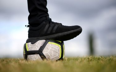 """A photograph taken on April 30, 2020 shows a football ball on the field of the amateur football club """"FC Parisis"""" at the club training centre, in Herblay, near Paris, on the 45th day of a lock-out in France aimed at stopping the spread of the COVID-19 pandemic, the new coronavirus. (Photo by FRANCK FIFE / AFP) (Photo by FRANCK FIFE/AFP via Getty Images)"""