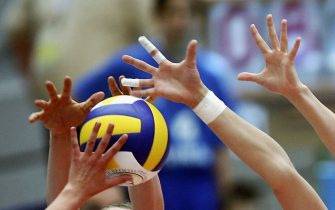 DRESDEN, GERMANY - JUNE 19:  player reach for the ball during the volleyball Women World Championships Qualifiers between Germany and Poland on June 19, 2005 in Dresden, Germany.  (Photo by Christian Fischer/Bongarts/Getty Images)