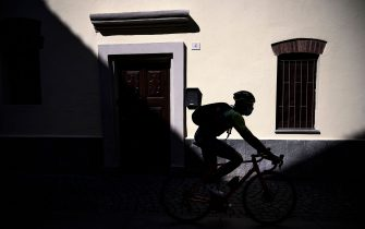 TOPSHOT - Vini Zabu - KTM rider Umberto Marengo rides his bicycle as he delivers goods during a day of delivery on April 22, 2020 in Collegno, near Turin, during the country's lockdown aimed at curbing the spread of the COVID-19 infection, caused by the novel coronavirus. - He should have been fine-tuning his preparation for the Tour of Italy, but the coronavirus pandemic has changed it all. In order to be useful to his community while keeping fit, Umberto Marengo, a professional cyclist, gets on his bike and acts as a delivery man instead. (Photo by MARCO BERTORELLO / AFP) (Photo by MARCO BERTORELLO/AFP via Getty Images)
