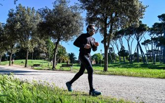 A man jogs in the park of the Villa Doria Pamphili in Rome on May 4, 2020, as Italy starts to ease its lockdown, during the country's lockdown aimed at curbing the spread of the COVID-19 infection, caused by the novel coronavirus. - Stir-crazy Italians will be free to stroll and visit relatives for the first time in nine weeks on May 4, 2020 as Europe's hardest-hit country eases back the world's longest nationwide coronavirus lockdown. (Photo by ANDREAS SOLARO / AFP) (Photo by ANDREAS SOLARO/AFP via Getty Images)
