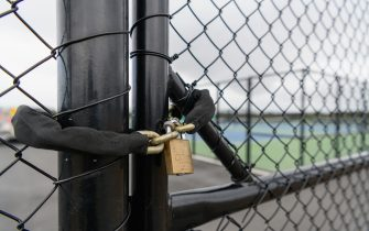 CHRISTCHURCH, NEW ZEALAND - MARCH 21: A lock is seen in front of the tennis courts at Nga Puna Wai on March 21, 2020 in Christchurch, New Zealand. Sporting codes across New Zealand have cancelled competition in response to the ongoing COVID-19 outbreak. The New Zealand government has imposed strict border restrictions, banning all foreign visitors into the country, while New Zealand citizens and residents are required to self-isolate for 14 days. Indoor gatherings of more than 100 people have been banned with the exception of workplaces, schools, supermarkets and public transport. (Photo by Kai Schwoerer/Getty Images)