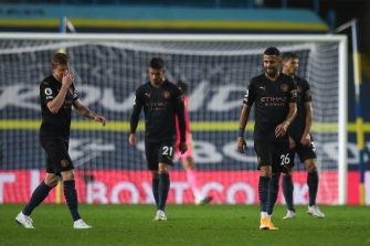 LEEDS, ENGLAND - OCTOBER 03: Dejected players of Manchester City react after conceding during the Premier League match between Leeds United and Manchester City at Elland Road on October 3, 2020 in Leeds, United Kingdom. Sporting stadiums around the UK remain under strict restrictions due to the Coronavirus Pandemic as Government social distancing laws prohibit fans inside venues resulting in games being played behind closed doors. (Photo by Robbie Jay Barratt - AMA/Getty Images)