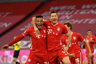 MUNICH, GERMANY - OCTOBER 04: Robert Lewandowski of Bayern Munich celebrates with Corentin Tolisso after scoring his team's fourth goal from the penalty spot during the Bundesliga match between FC Bayern Muenchen and Hertha BSC at Allianz Arena on October 04, 2020 in Munich, Germany. (Photo by Sebastian Widmann/Getty Images)