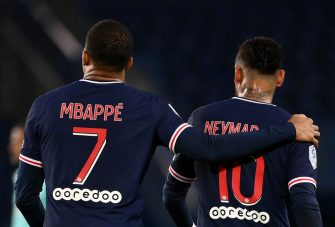 Paris Saint-Germain's French forward Kylian MBappe (L) Paris Saint-Germain's Brazilian forward Neymar reacts during the French L1 football match between Paris Saint-Germain (PSG) and Angers (SCO) at the Parc des Princes stadium in Paris on October 2, 2020. (Photo by FRANCK FIFE / AFP) (Photo by FRANCK FIFE/AFP via Getty Images)