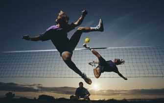 Competitors acrobatically jump to kick the ball over the net during a Sepak Takraw (Kick-Volleyball) match on the beach at sunset on1 June 1991 at Malibu, California, United States. Visions of Sport. (Photo by Mike Powell/Allsport/Getty Images)