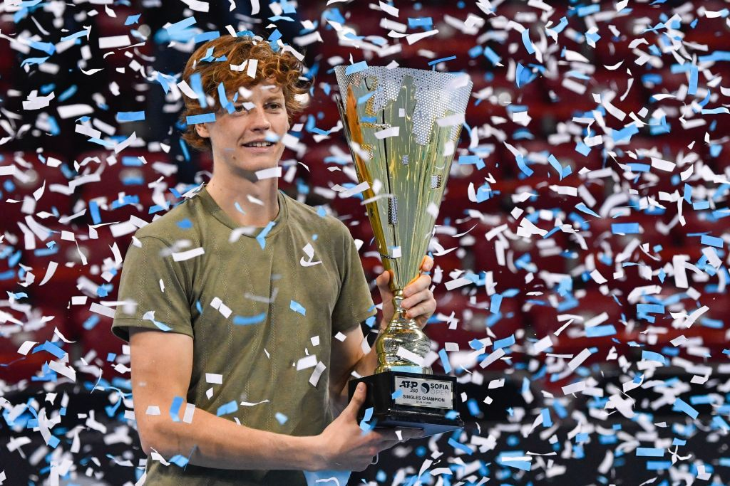 Italian tennis player Jannik Sinner celebrates with the trophy during the podium ceremony after winning the final against his Canadian opponent at the ATP 250 Sofia Open tennis tournament in Sofia, on November 14, 2020. (Photo by NIKOLAY DOYCHINOV / AFP) (Photo by NIKOLAY DOYCHINOV/AFP via Getty Images)