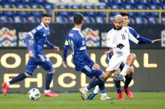 epa08827941 Lorenzo Insigne (R) of Italy in action against Miralem Pjanic (C) of Bosnia and Hercegovina during the UEFA Nations League, League A, group 1 soccer match, between Bosnia and Herzegovina and Italy in Sarajevo, Bosnia and Herzegovina, 18 November 2020.  EPA/FEHIM DEMIR