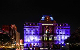 epa08842753 The Kirchner Cultural Center is illuminated with a projection of Diego Armando Maradona as a posthumous tribute in Buenos Aires, Argentina, 25 November 2020. Maradona died on 25 November 2020 following a heart attack, aged 60.  EPA/Juan Ignacio Roncoroni