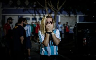 epa08842749 Fans gather to honor Diego Armando Maradona at the Club Argentinos Juniors Stadium, in Buenos Aires, Argentina, 25 November 2020. Diego Maradona has died at the age of 60 after a heart attack on 25 November 2020.  EPA/Juan Ignacio Roncoroni