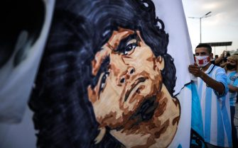 epa08842622 Hundreds of people gather at the Obelisk to say goodbye to Diego Armando Maradona, in Buenos Aires, Argentina, 25 November 2020. Diego Maradona has died at the age of 60 after a heart attack on 25 November 2020.  EPA/Juan Ignacio Roncoroni