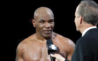 epa08850195 Mike Tyson reacts after receiving a split draw against Roy Jones Jr. during Mike Tyson vs Roy Jones Jr. fight at the Staples Center in Los Angeles, California, USA, 28 November 2020.  EPA/JOE SCARNICI  HANDOUT EDITORIAL USE ONLY/NO SALES