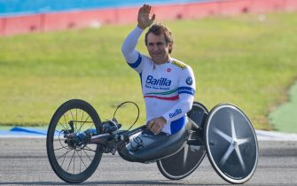 epa08558560 epa08497150 (FILE) - Handbiker and former racing driver Alex Zanardi of Italy drives on the Hockenheimring racetrack before the last race of the season of the Deutsche Tourenwagen Meisterschaft (DTM) in Hockenheim, Germany, 21 October 2012 (reissued 21 July 2020). Alex Zanardi was transferred on 21 July 2020 to a specialized rehabilitation center after being suspended from sedation. The four-time paralympic champion and former Formula One driver Alex Zanardi was involved in a serious road accident on 19 June 2020 in the province of Siena while taking part in a race on his handbike during one of the stages of the relay of Obiettivo tricolore. Zinardi underwent a brain surgery after suffering a severe cranial trauma and is in serious condition, according to reports.  EPA/UWE ANSPACH GERMANY OUT *** Local Caption *** 56164068