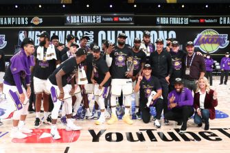 ORLANDO, FL - OCTOBER 11: The Los Angeles Lakers poses for a photo together after winning Game Six of the NBA Finals on October 11, 2020 at AdventHealth Arena in Orlando, Florida. NOTE TO USER: User expressly acknowledges and agrees that, by downloading and/or using this Photograph, user is consenting to the terms and conditions of the Getty Images License Agreement. Mandatory Copyright Notice: Copyright 2020 NBAE (Photo by Nathaniel S. Butler/NBAE via Getty Images)
