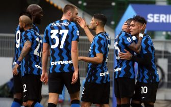 Inter Milan's Lautaro Martinez (R) jubilates with his teammates  after scoring goal of 2  to 1 during the Italian serie A soccer match  between Fc Inter and Crotone at Giuseppe Meazza stadium in Milan 3 January  2021.ANSA / MATTEO BAZZI