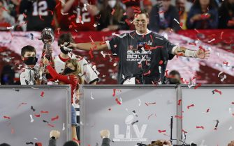 epaselect epa08995265 Tampa Bay Buccaneers quarterback Tom Brady celebrates with the Vince Lombardi Trophy as he stands with children (L-R) Benjamin, Jack and Vivian after the Buccaneers deafeated the Kansas City Chiefs to win the National Football League Super Bowl LV at Raymond James Stadium in Tampa, Florida, USA, 07 February 2021.  EPA/ERIK S. LESSER