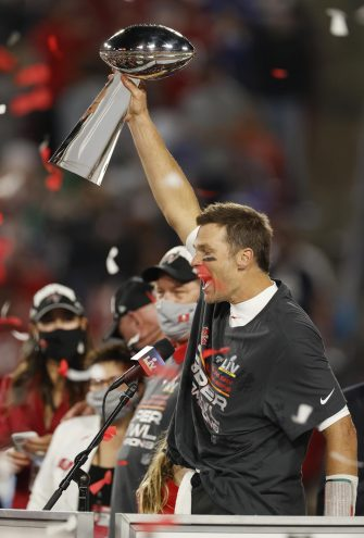 epa08995244 Tampa Bay Buccaneers quarterback Tom Brady celebrates with the Vince Lombardi Trophy after the Buccaneers deafeated the Kansas City Chiefs to win the National Football League Super Bowl LV at Raymond James Stadium in Tampa, Florida, USA, 07 February 2021.  EPA/CJ GUNTHER