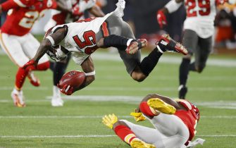 epa08995011 Kansas City Chiefs wide receiver Byron Pringle (R) upends Tampa Bay Buccaneers Jaydon Mickens (L) in the second quarter of the National Football League Super Bowl LV at Raymond James Stadium in Tampa, Florida, USA, 07 February 2021.  EPA/CJ GUNTHER