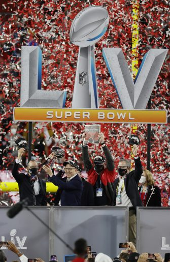 epa08995253 Tampa Bay Buccaneers ownership including Joel Glazer holding the Vince Lombardi Trophy celebrate after the Buccaneers defeated the Kansas City Chiefs to win the National Football League Super Bowl LV at Raymond James Stadium in Tampa, Florida, USA, 07 February 2021.  EPA/ERIK S. LESSER