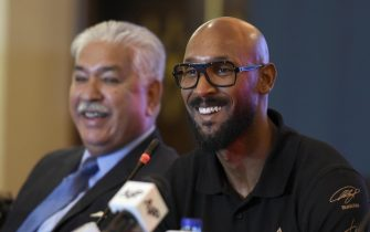 epa07415787 Former French soccer player Nicolas Anelka  (R) talks with journalists after he arrived to promote soccer in the country in Islamabad, Pakistan, 05 May 2019.  EPA/T. MUGHAL