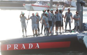 Crew members of Prada Luna Rossa celebrate their victory against INEOS Team UK during day five of the final of the Prada Cup 2021, the challengers series of the 36th America's Cup, on Auckland Harbour in Auckland on February 21, 2021. (Photo by MICHAEL BRADLEY / AFP) (Photo by MICHAEL BRADLEY/AFP via Getty Images)