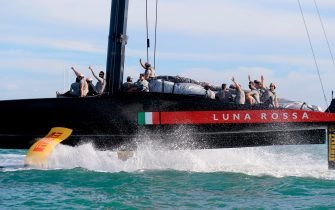 Luna Rossa Prada Pirelli team celebrate victory in the Prada Cup final against INEOS Team UK in Auckland on February 21, 2021. (Photo by Gilles Martin-Raget / AFP) (Photo by GILLES MARTIN-RAGET/AFP via Getty Images)
