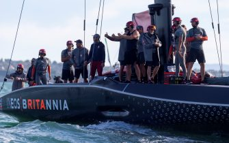 INEOS Team UK greet Luna Rossa Prada Pirelli team over their vitory in the Prada Cup final in Auckland on February 21, 2021. (Photo by Gilles Martin-Raget / AFP) (Photo by GILLES MARTIN-RAGET/AFP via Getty Images)