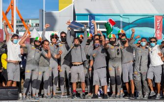 Luna Rossa Prada Pirelli team celebrate with the 2021 Prada Cup trophy after defeating INEOS Team UK in the final at Auckland Harbour on February 21, 2021. (Photo by Gilles Martin-Raget / AFP) (Photo by GILLES MARTIN-RAGET/AFP via Getty Images)