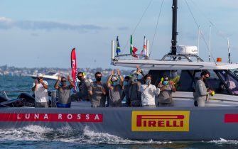 Luna Rossa Prada Pirelli team members celebrate after winning the final of 2021 Prada Cup, the 36th America's Cup challenger series, in Auckland on February 21, 2021. (Photo by Gilles Martin-Raget / AFP) (Photo by GILLES MARTIN-RAGET/AFP via Getty Images)