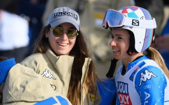 epa09021607 Injured Italian ski racer Sofia Goggia (L) and Marta Bassino of Italy (R) during the 2nd run of the Women's Giant Slalom race at the FIS Alpine Skiing World Championships in Cortina d'Ampezzo, Italy, 18 February 2021.  EPA/CHRISTIAN BRUNA