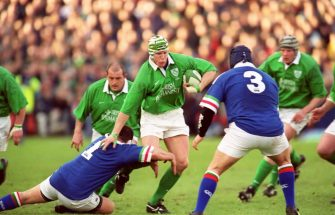 Ireland's Guy Easterby (c) overcomes a tackle from Italy's Massimo Cuttitta (l)  (Photo by Steve Mitchell/EMPICS via Getty Images)