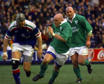 Ireland's captain Keith Woods (centre) breaks from the pack with Massimo Cuttitta (left) of  Italy giving chase during the Six Nations Championship rugby match at Lansdowne Road Dublin.   (Photo by Chris Bacon - PA Images/PA Images via Getty Images)
