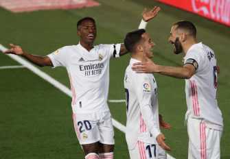 epa09127717 Real Madrid's Karim Benzema (R) celebrates with teammates Vinicius Jr (L) and Lucas Vazquez after scoring the 1-0 lead during the Spanish LaLiga soccer match between Real Madrid and FC Barcelona at Alfredo di Stefano stadium in Madrid, Spain, 10 April 2021.  EPA/JUANJO MARTIN