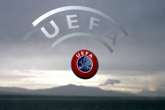 Nyon, SWITZERLAND:  A UEFA logo is seen with Geneva Lake and Alps as background 08 December 2006 during a press conference closing a two days Executive committee meeting of the European football federation at the headquarters in Nyon. AFP PHOTO / FABRICE COFFRINI  (Photo credit should read FABRICE COFFRINI/AFP via Getty Images)