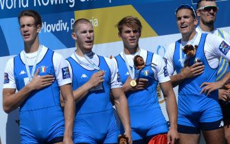 epa07021870 Filippo Mondelli, Andrea Panizza, Luca Rambaldi and Giacomo Gentili from Italy celebrate on the podium after wining a gold medal in the Mens Quadruple Sculls final A\ at the World Rowing Championship 2018 in Plovdiv, Bulgaria, 15 September 2018.  EPA/BORISLAV TROSHEV