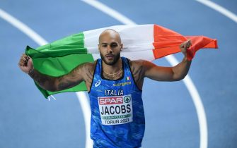 epa09058005 Lamont Marcell Jacobs of Italy reacts after winning the men's 60m final at the 36th European Athletics Indoor Championships at the Arena Torun, in Torun, north-central Poland, 06 March 2021.  EPA/Adam Warzawa POLAND OUT