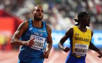 epa07874385 Lamont Marcell Jacobs (L) of Italy and Mario Burke (R) of Barbados cross the finish line during the men's 100m heats at the IAAF World Athletics Championships 2019 at the Khalifa Stadium in Doha, Qatar, 27 September 2019. EPA/SRDJAN SUKI