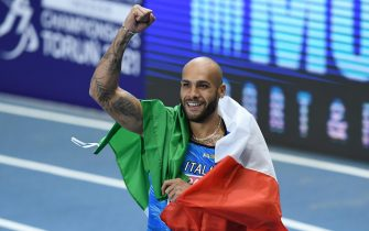 epa09058004 Lamont Marcell Jacobs of Italy reacts after winning the men's 60m final at the 36th European Athletics Indoor Championships at the Arena Torun, in Torun, north-central Poland, 06 March 2021.  EPA/Adam Warzawa POLAND OUT