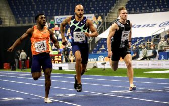 epa08989831 (L-R) Arthur Cisse of the Ivory Coast, Lamont Marcell Jacobs of the USA and Kevin Kranz of Germany compete in the men's 60m final at the ISTAF Indoor international athletics meeting in Berlin, Germany, 05 February 2021.  EPA/Maja Hitij / POOL