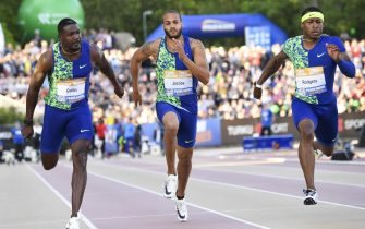 epa07641420 (L-R) Justin Gatlin of USA, Lamont Marcell Jacobs of Italy and Mike Rodgers of USA in action during the Men's 100 mt final at the athletics Paavo Nurmi Games in Turku, Finland, 11 June 2019.  EPA/KIMMO BRANDT