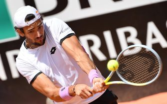 Matteo Berrettini of Italy in action against Stefanos Tsitsipas of Greece during their men's singles third round match at the Italian Open tennis tournament in Rome, Italy, 13 May 2021.  ANSA/ETTORE FERRARI
