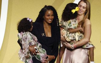 UNCASVILLE, CONNECTICUT - MAY 15: Professional basketball player Sabrina Ionescu and Ciara hold Kobe Bryant's daughters Capri and Bianka on-stage following the 2021 Basketball Hall of Fame Enshrinement Ceremony at Mohegan Sun Arena on May 15, 2021 in Uncasville, Connecticut. (Photo by Maddie Meyer/Getty Images)