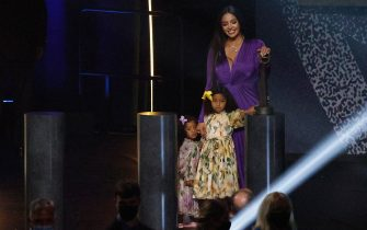 UNCASVILLE, CONNECTICUT - MAY 15: Vanessa Bryant stands with daughters Capri and Bianka after speaking on behalf of Class of 2020 inductee, Kobe Bryant during the 2021 Basketball Hall of Fame Enshrinement Ceremony at Mohegan Sun Arena on May 15, 2021 in Uncasville, Connecticut. Kobe Bryant tragically died in a California helicopter crash on Jan 26, 2020. (Photo by Maddie Meyer/Getty Images)