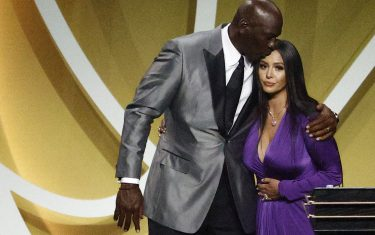 UNCASVILLE, CONNECTICUT - MAY 15: Vanessa Bryant is greeted by presenter Michael Jordan after speaking on behalf of Class of 2020 inductee, Kobe Bryant during the 2021 Basketball Hall of Fame Enshrinement Ceremony at Mohegan Sun Arena on May 15, 2021 in Uncasville, Connecticut. Kobe Bryant tragically died in a California helicopter crash on Jan 26, 2020. (Photo by Maddie Meyer/Getty Images)