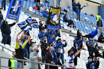 REGGIO NELL'EMILIA, ITALY - MAY 19: Fans interact from their seat in the stands during the TIMVISION Cup Final between Atalanta BC and Juventus on May 19, 2021 in Reggio nell'Emilia, Italy. A limited number of fans will be allowed into the stadium as Coronavirus restrictions begin to ease in the UK. (Photo by Marco Rosi/Getty Images for Lega Serie A)