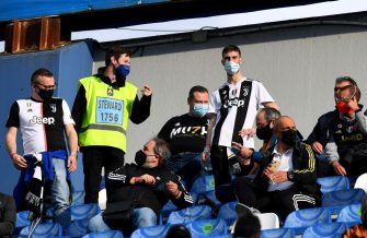 REGGIO NELL'EMILIA, ITALY - MAY 19: Fans of Juventus interact with a steward from their seat inside of the stadium  during the TIMVISION Cup Final between Atalanta BC and Juventus on May 19, 2021 in Reggio nell'Emilia, Italy. A limited number of fans will be allowed into the stadium as Coronavirus restrictions begin to ease in the UK. (Photo by Claudio Villa/Getty Images for Lega Serie A)