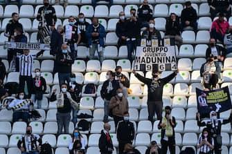Juventus fans attend the final of the Italian Cup (Coppa Italia) football match Atalanta Bergamo vs Juventus Turin on May 19, 2021 at the Citta del Tricolore stadium in Reggio Emilia. (Photo by MIGUEL MEDINA / AFP) (Photo by MIGUEL MEDINA/AFP via Getty Images)