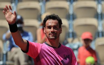 epa09236664 Fabio Fognini of Italy celebrates winning against Gregoire Barrere of France during their first round match at the French Open tennis tournament at Roland ?Garros in Paris, France, 30 May 2021.  EPA/CHRISTOPHE PETIT TESSON