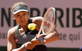 epaselect epa09236525 Naomi Osaka of Japan in action against Patricia Maria Tig of Romania during their first round match at the French Open tennis tournament at Roland ?Garros in Paris, France, 30 May 2021.  EPA/CAROLINE BLUMBERG
